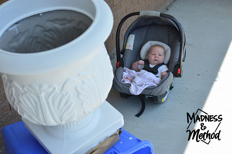 painting the planter white with baby in background