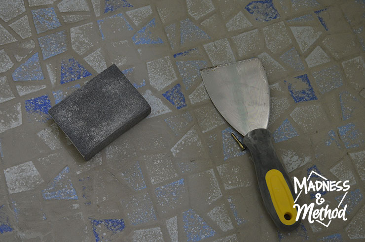 sanding sponge and trowel