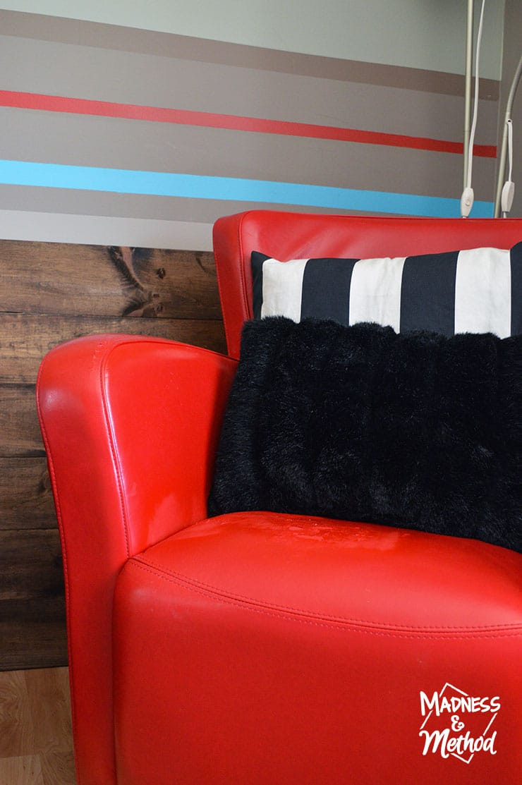 red leather chair with pillows