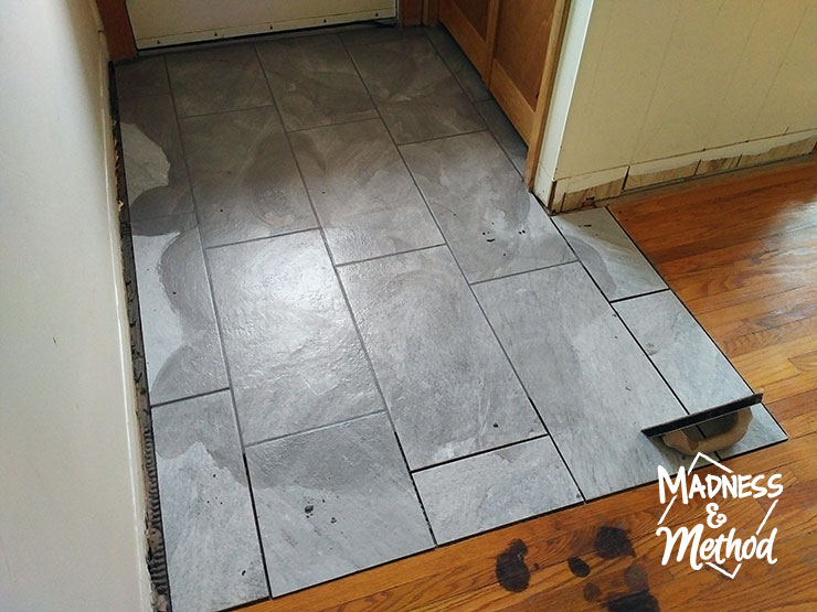 grouting the tiled floors