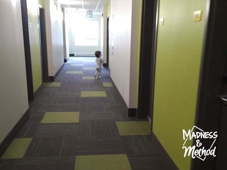 toddler in hotel hallway