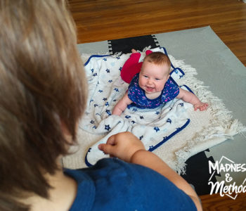 baby on mat and toddler