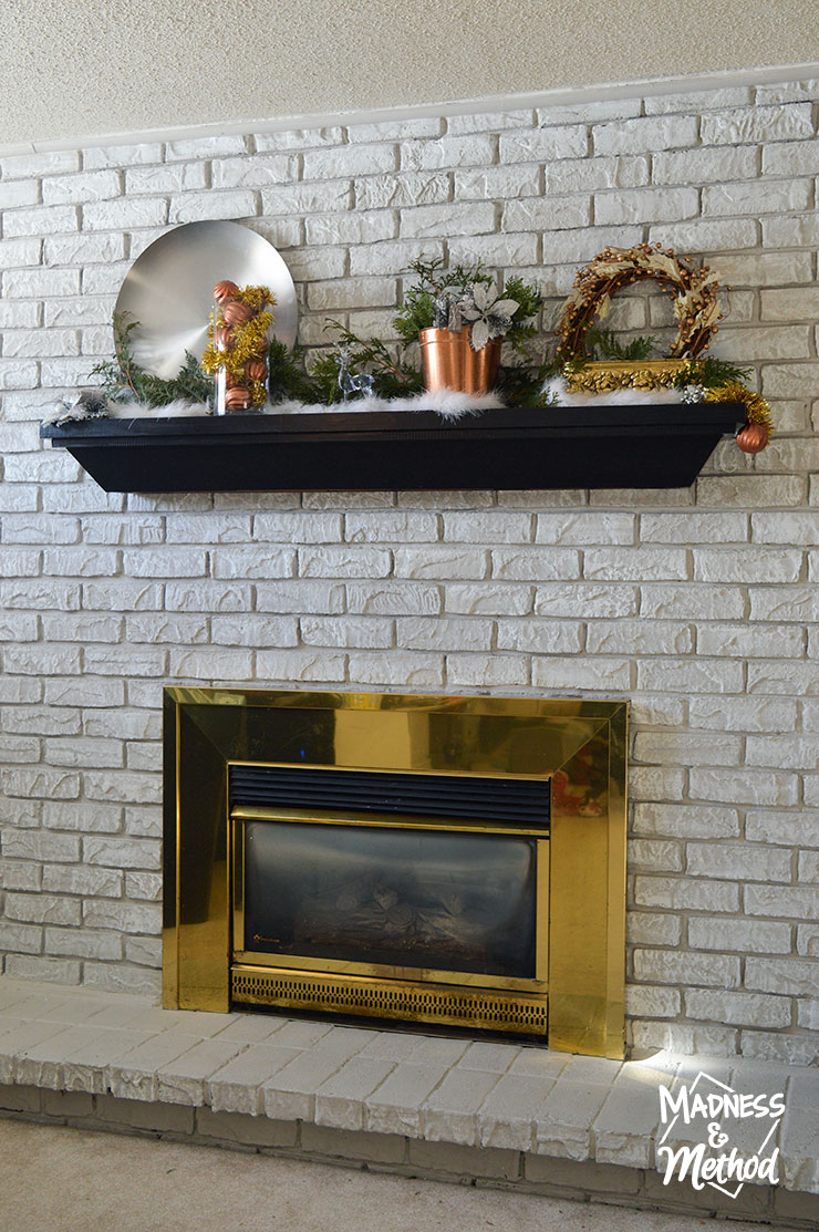 shiny brass fireplace surround