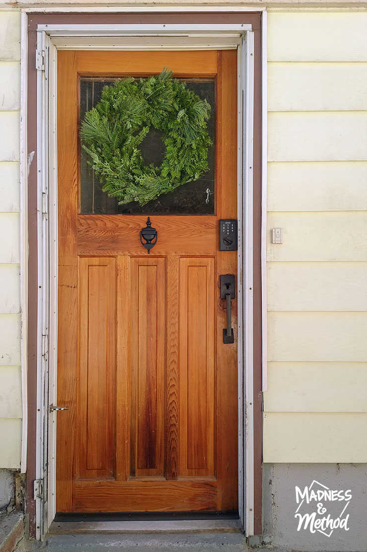 wood door with green wreath
