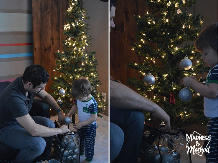 toddler helping with tree