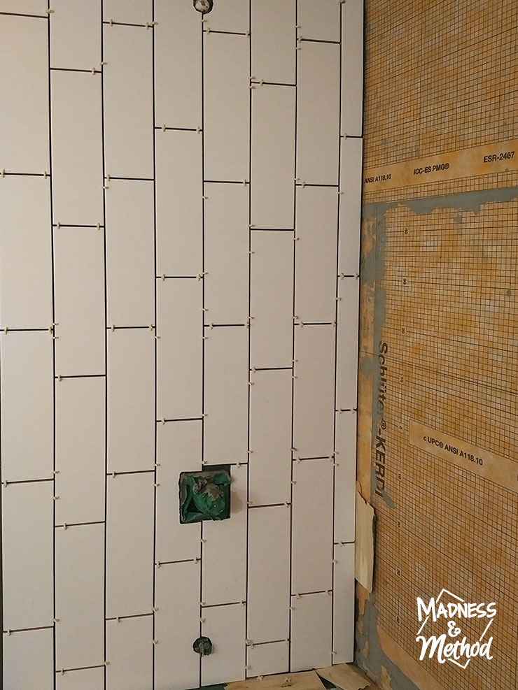 starting tile pattern in bathtub