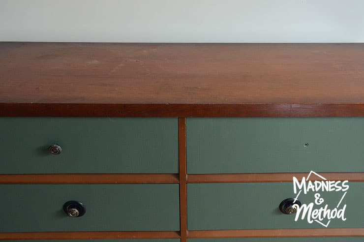 wood dresser with green drawers