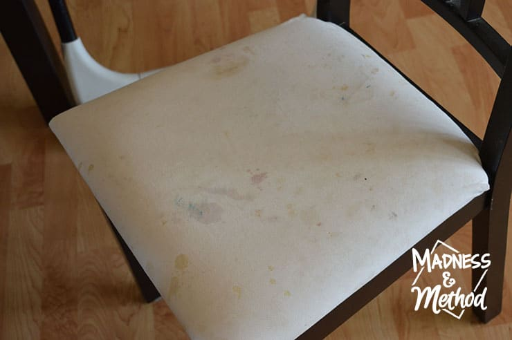 white messy dining chairs