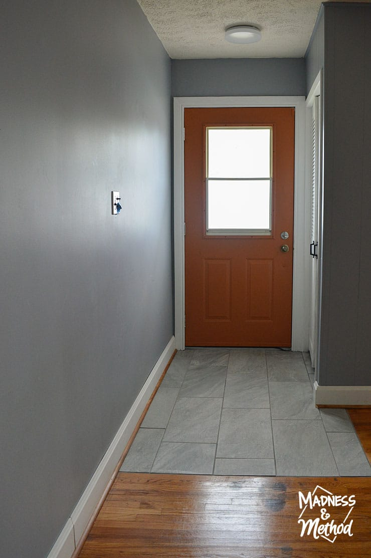 blue gray walls with orange door