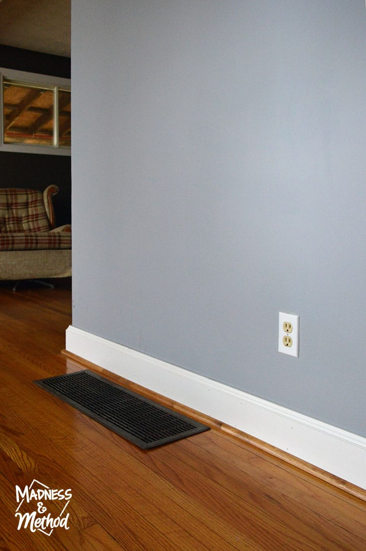 grey blue walls with hardwood floors
