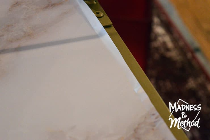 cutting marble wallpaper along edges