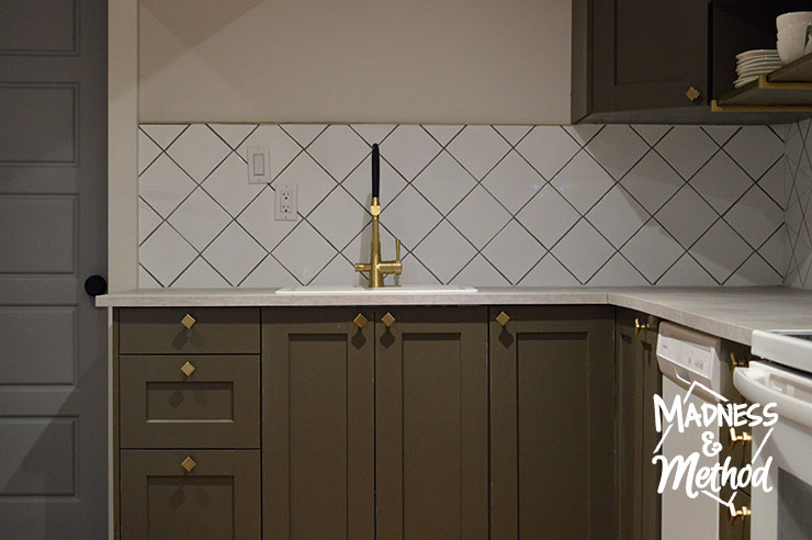 gold faucet with white backsplash