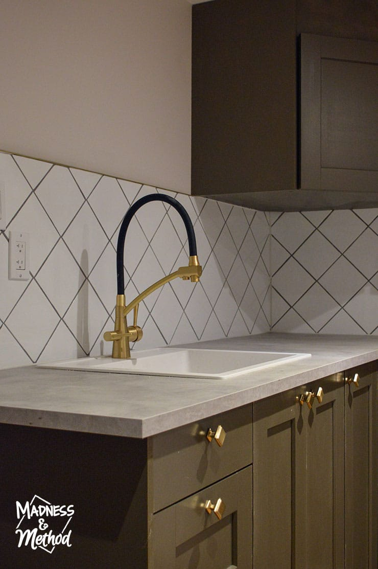 gold faucet and white sink