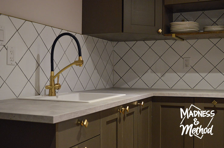 white backsplash and gray counters