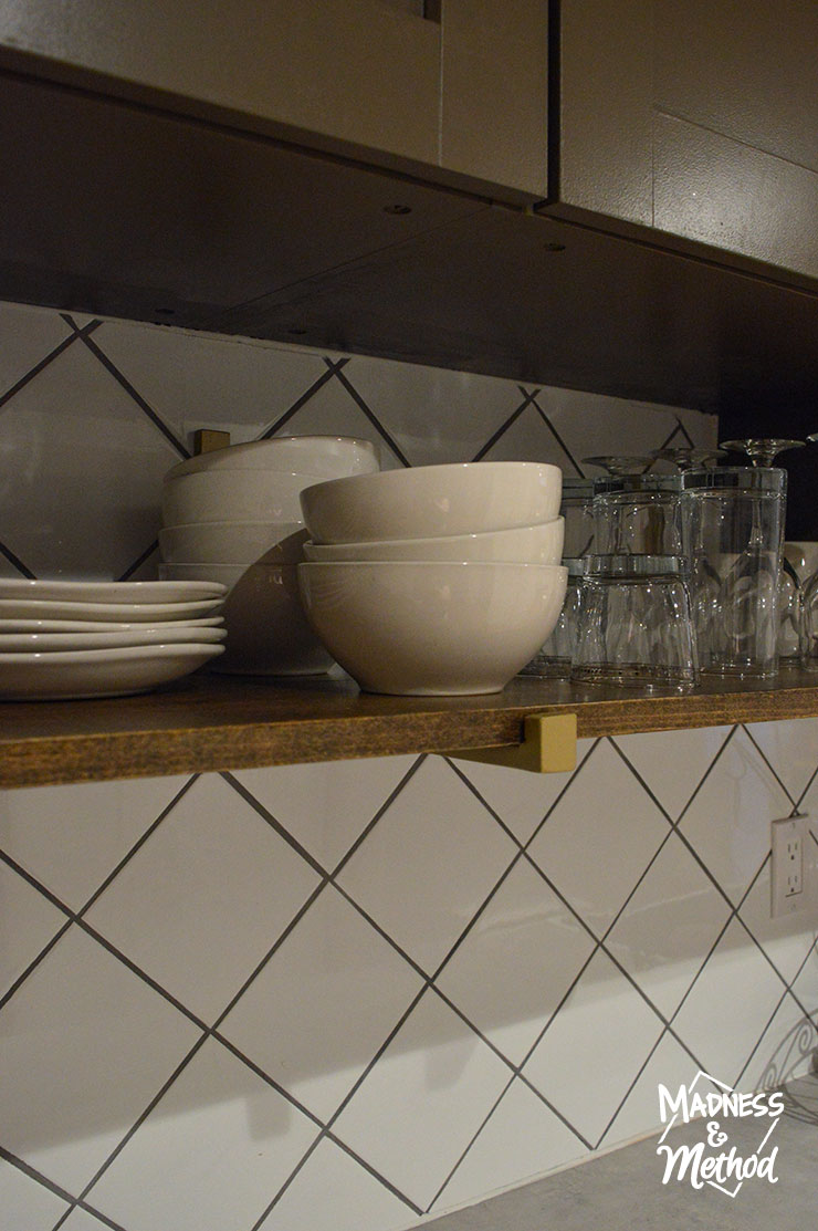 kitchen shelf holding cups