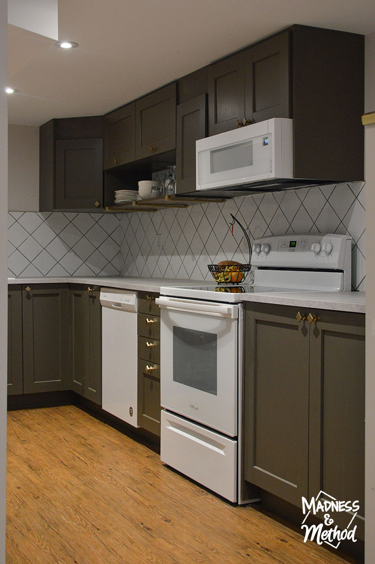 dark cabinets with white appliances