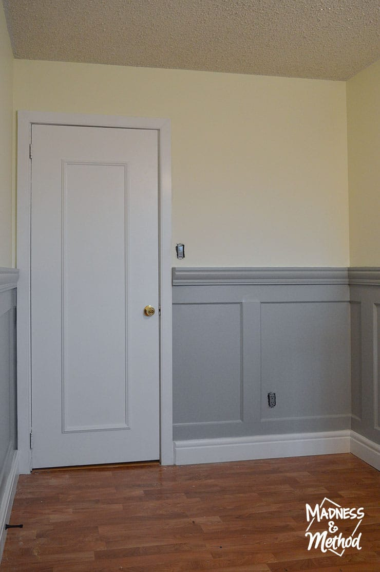 gray wainscoting with white door