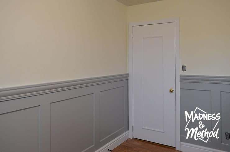 gray wainscoting and white baseboards