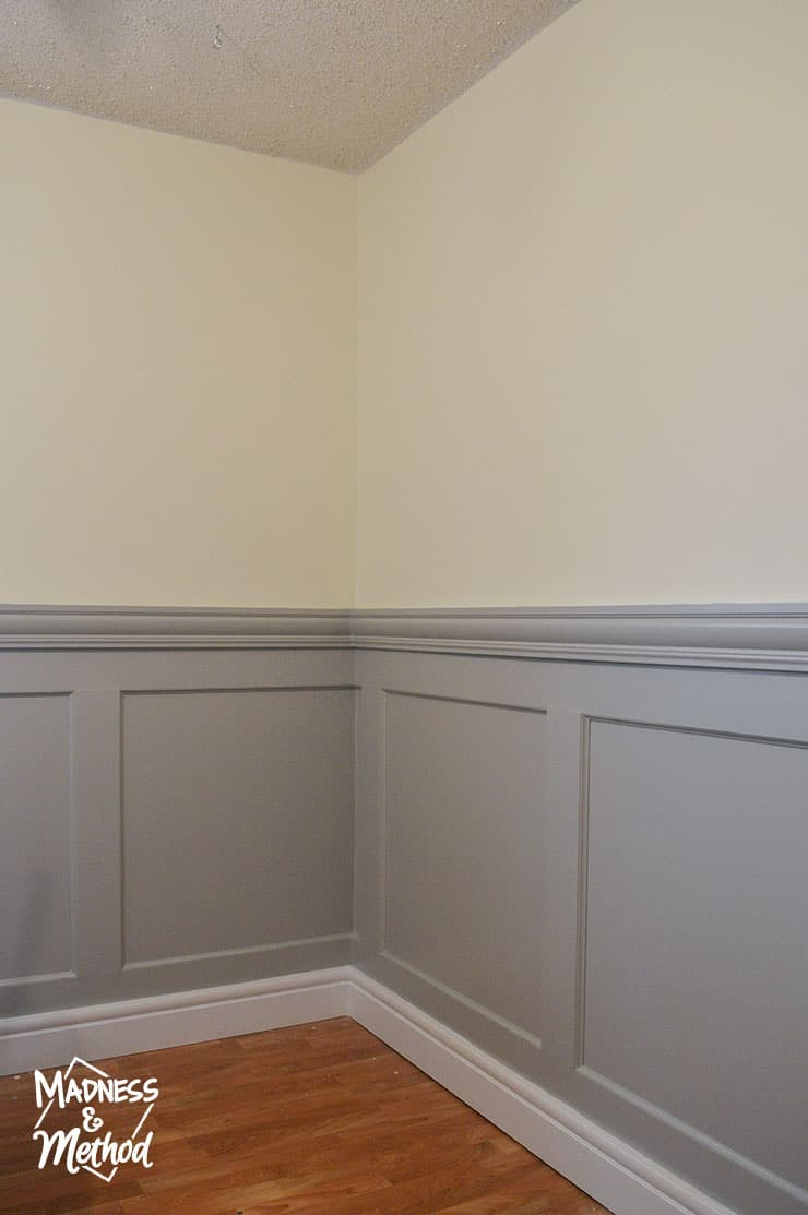 grey wainscoting with yellow walls