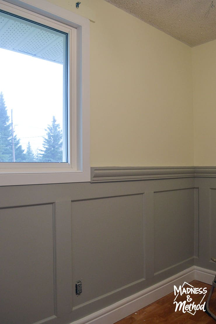 wainscoting with white windows