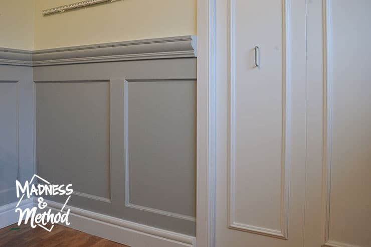 white doors and gray wainscoting