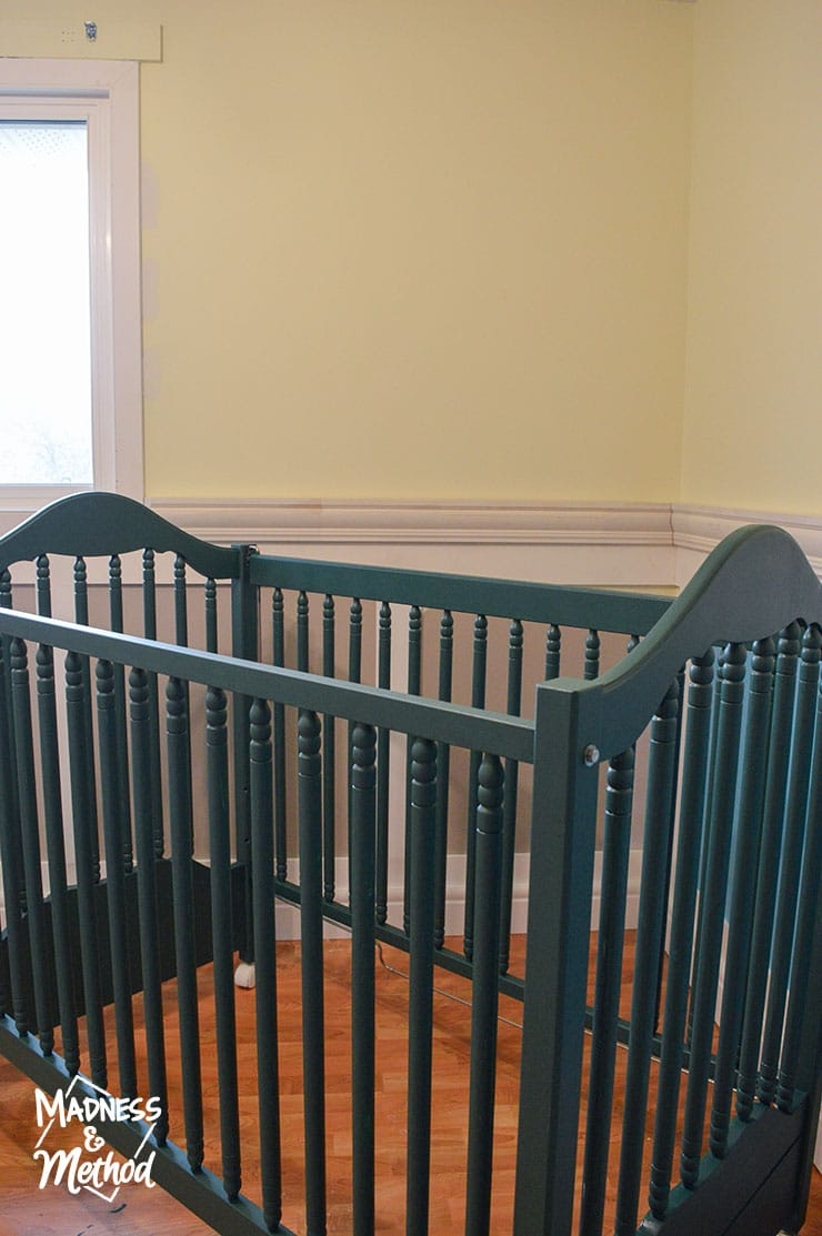 dark teal crib yellow walls