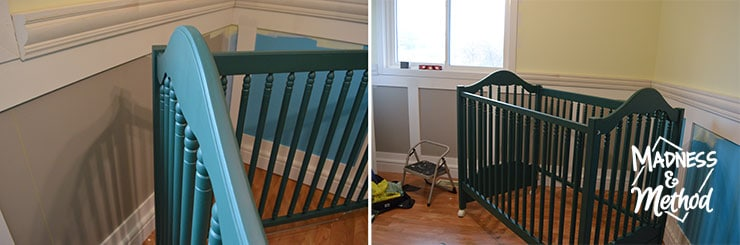 dark teal crib in room