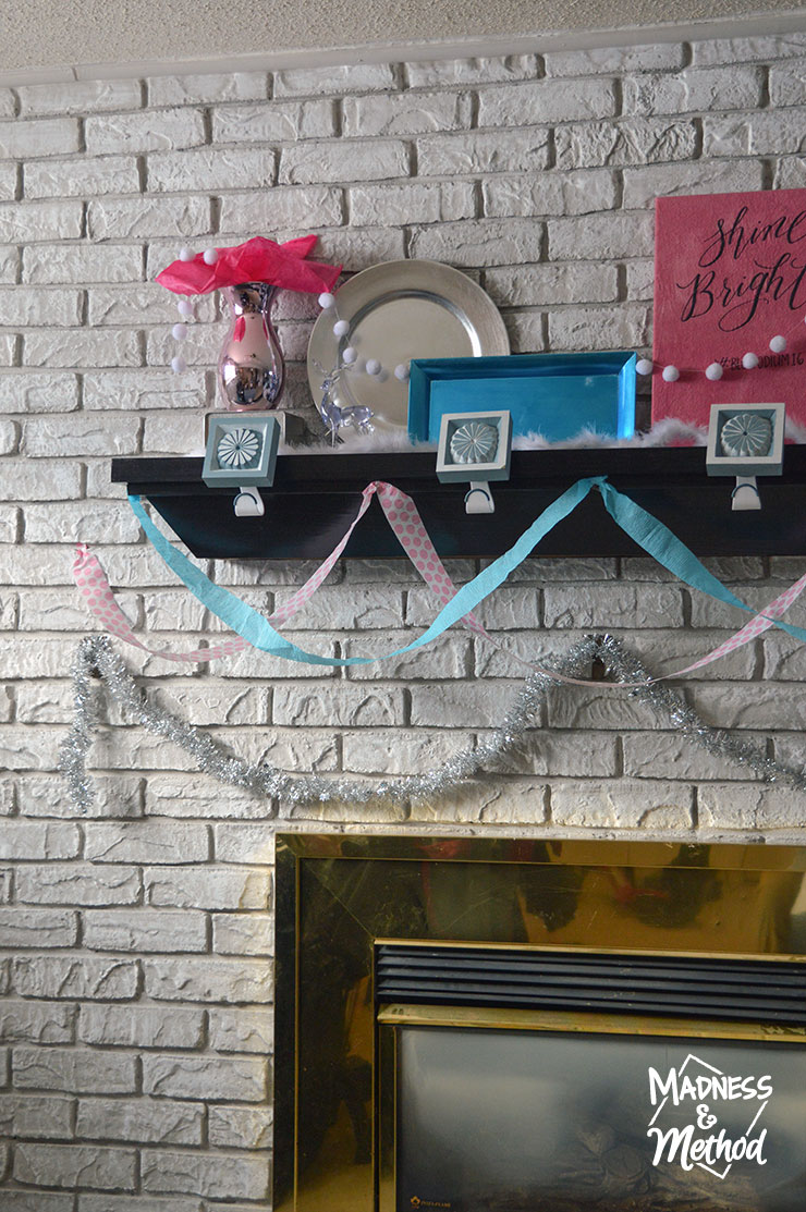 blue and pink baby mantel decor