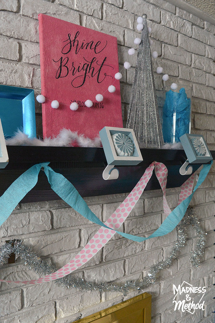 pink and blue mantel decor