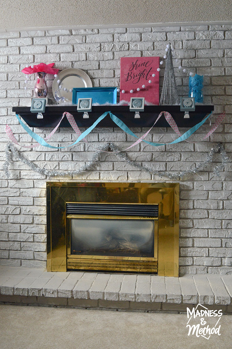 white bricks with pink and blue mantel