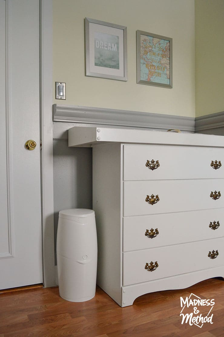 change table in nursery with diaper genie