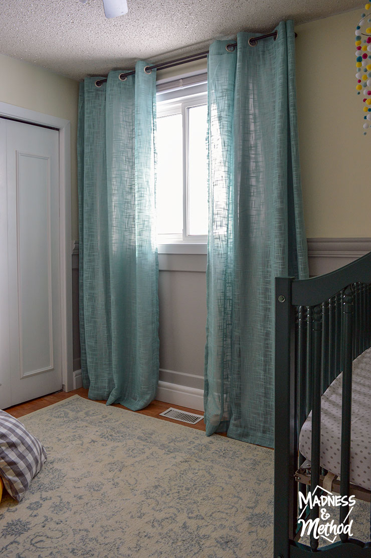 teal blinds with yellow walls