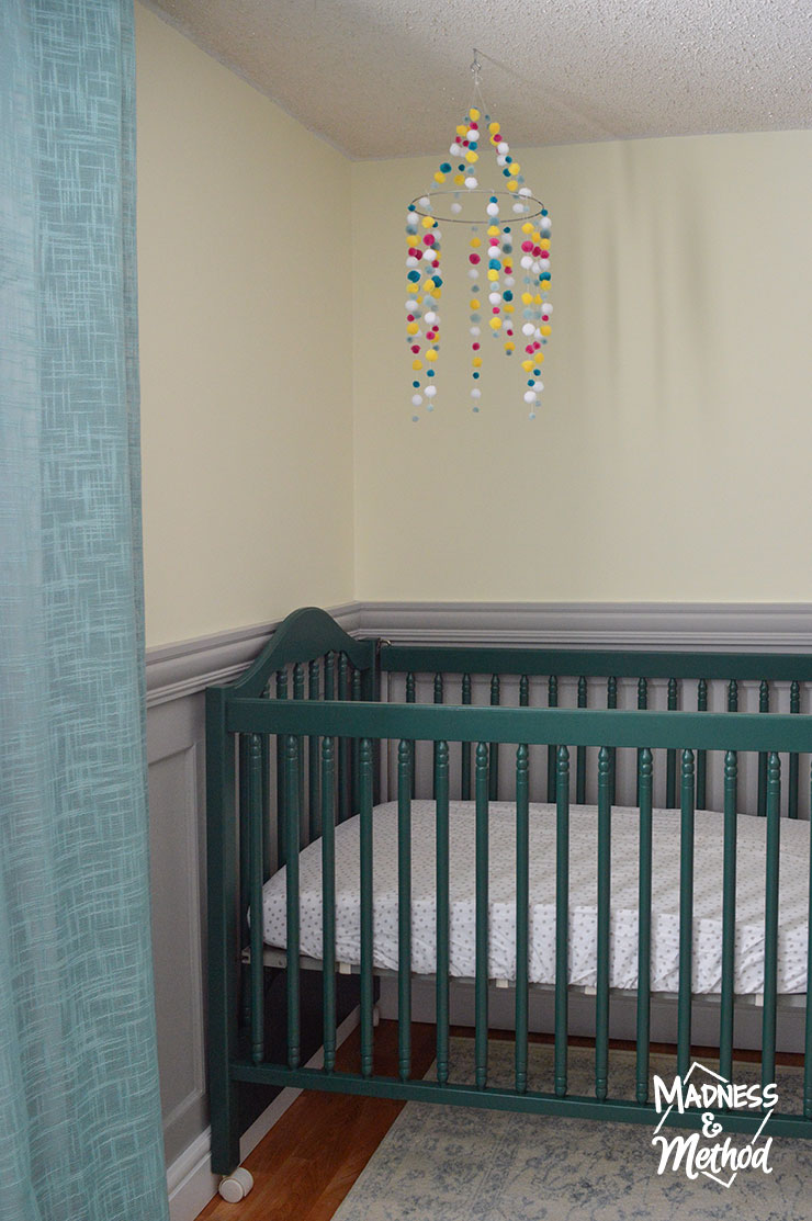 dark teal crib and aqua curtains