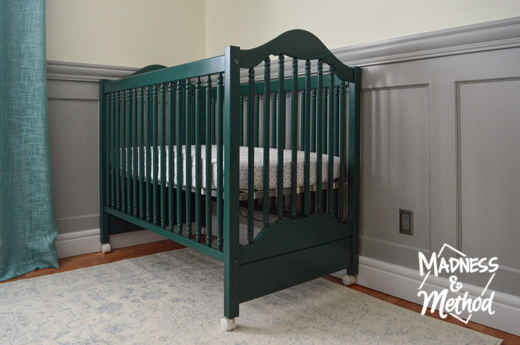 dark teal crib and light rug
