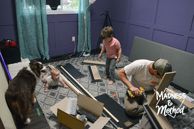 assembling a bed with storage