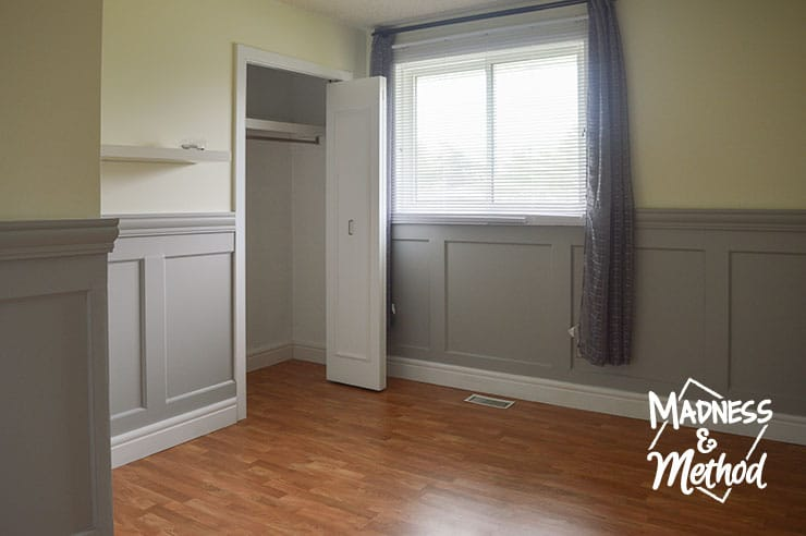 yellow bedroom with grey wainscoting