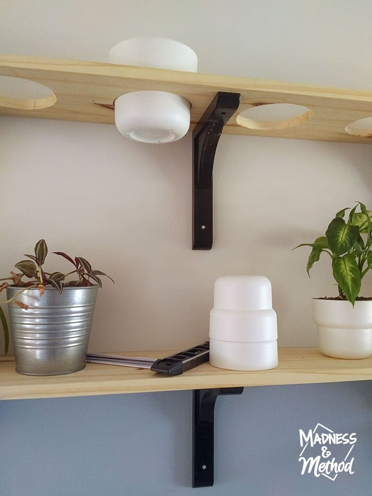 drilling holes into shelves