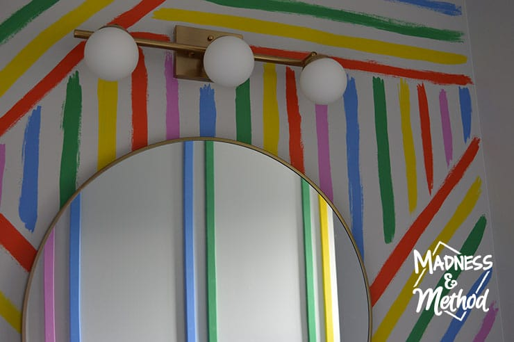 rainbow stripes round mirror