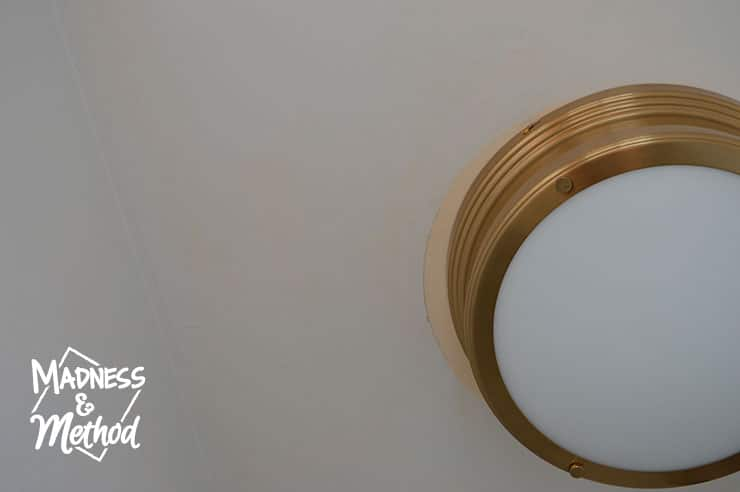 gold flushmount on ceiling