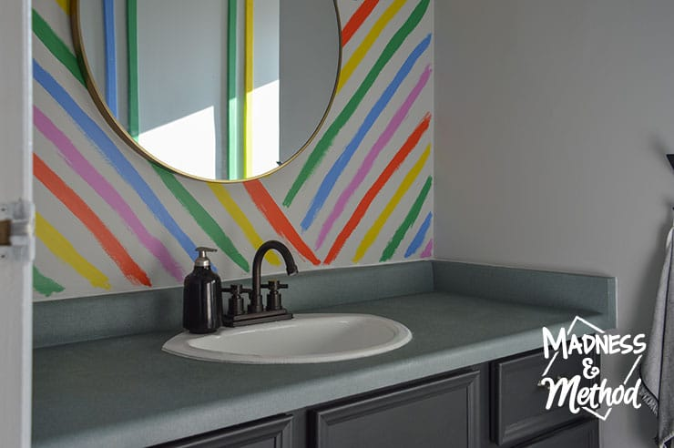 rainbow bathroom accent wall