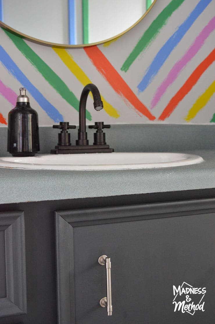 black vanity rainbow wall