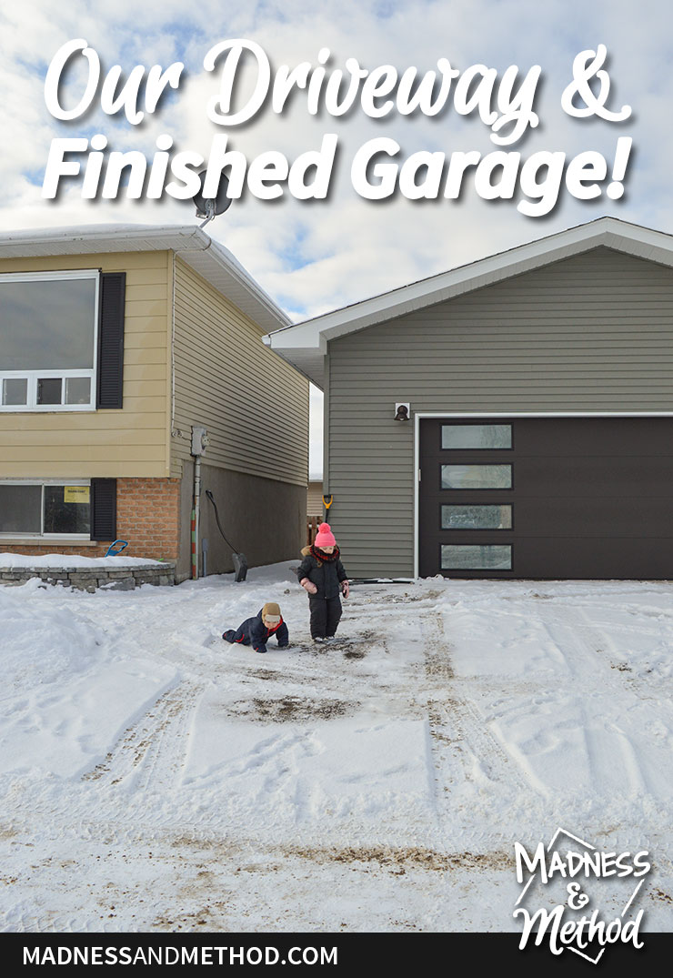 snow covered driveway and finished garage