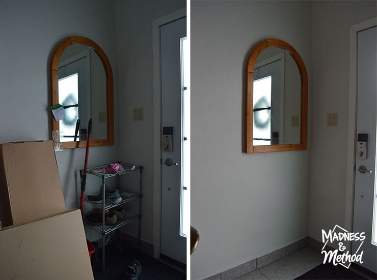wood arched mirror in entry