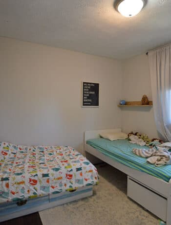two twin beds in small room