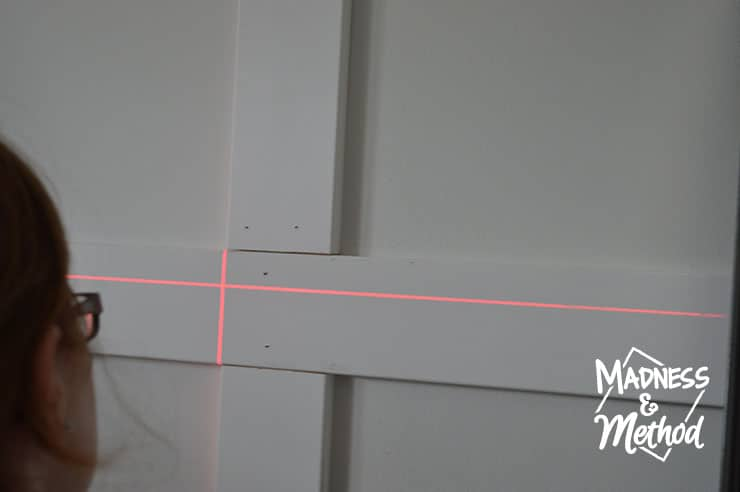 using laser level to install wall treatment