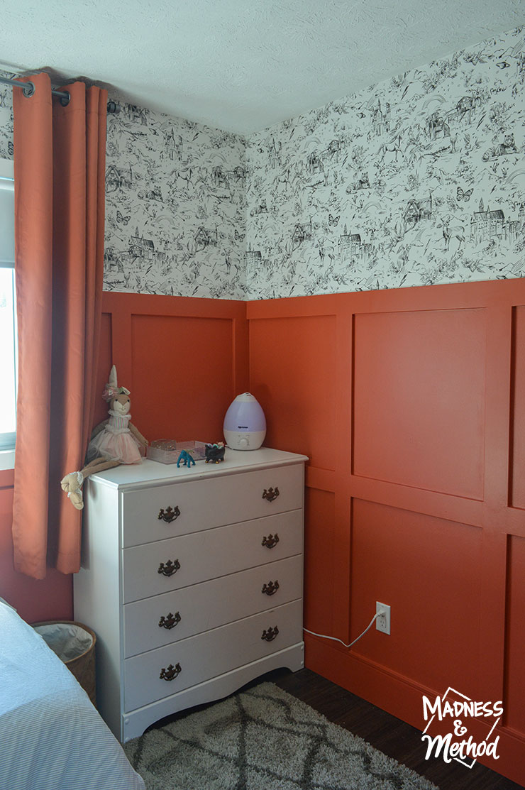 white dresser with red walls