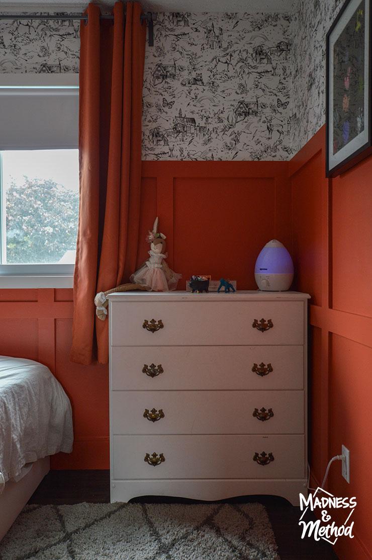 red walls white dresser gray carpet