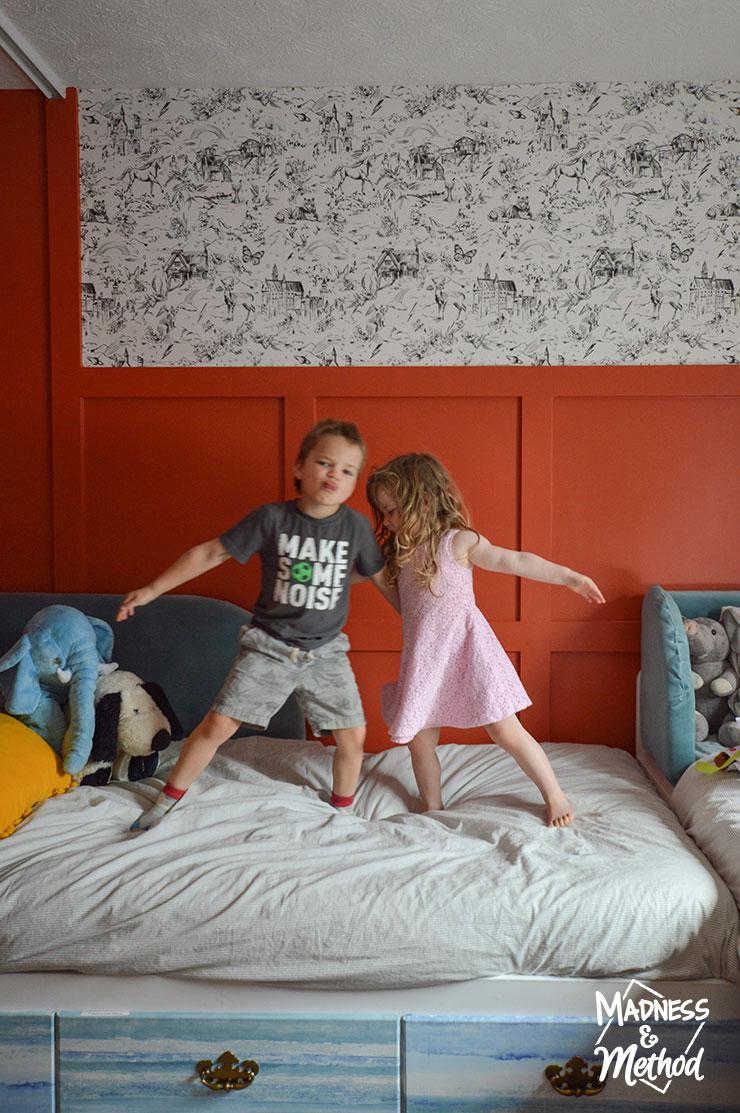 kids dancing on bed