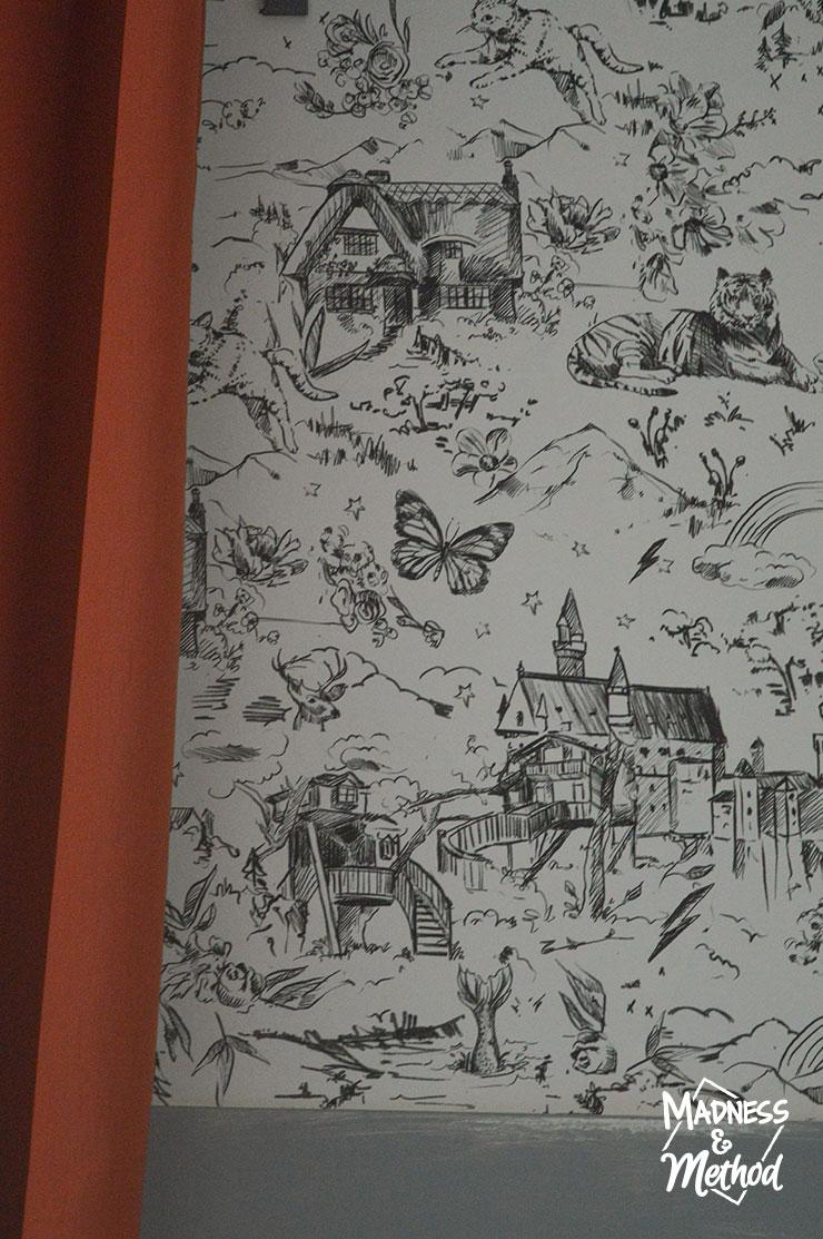 mixed wallpaper hidden behind curtain