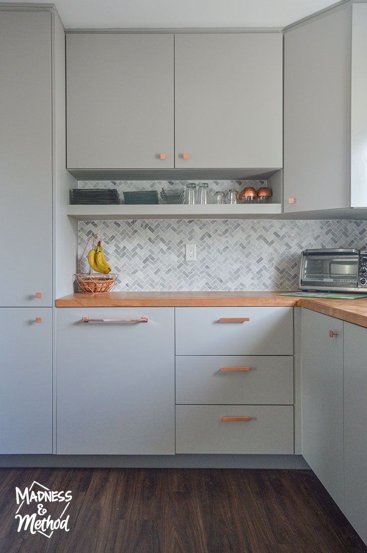 gray cabinets wood counters